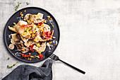 Pasta with mushrooms and pancetta crumb