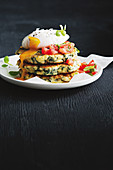 Silverbeet and artichoke fritters with poached egg
