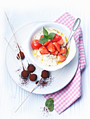 Rice pudding with vanilla, strawberries and ice cream