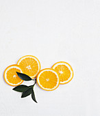 Four orange slices with leaves
