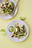 Fish tacos with iceberg lettuce, an avocado dip, and micro herbs