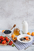 Healthy breakfast cereal with fruit and honey