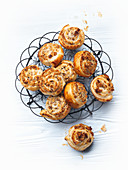 Puff pastry snails filled with nuts