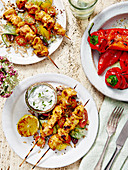 Mediteranean Chicken Kebabs served with rice and salad