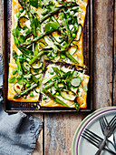 A Spring Pea Asperagus and Corgette Tart with a cut slice