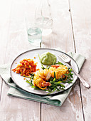 King prawns in a potato coating with red lentils