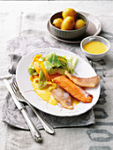 Fish fillets on pointed cabbage with roast potatoes