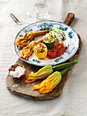 A trio of stuffed courgettes and courgette flowers