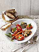 Antipasti: aubergines with tomato sauce, mushrooms, courgettes and candied carrots