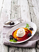Yoghurt panna cotta with berry sauce