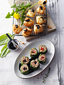 Wild herb sushi and puff pastry pralines with black nuts