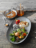 Goat's cheese specialities with a wild herb salad