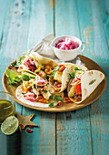 Spicy fish tacos with red onions