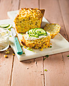 Cornbread with butter and cucumber slices