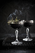 Blackberry, vodka and smoking rosemary Martinis