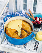 Self-saucing pudding (one-pot) with vanilla sauce