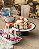 Muesli balls with chocolate and cranberries, with coconut-berry popsicles