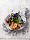 A mini vegetable quiche with a colourful salad