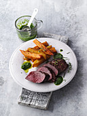 Saddle of venison with chips and a herb sauce