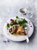 Herb salad with black pudding and cabbage strudel