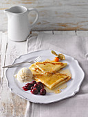 Crepes Suzette with vanilla ice cream and sour cherries