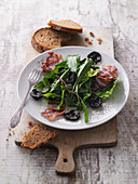 Salad with black nuts and Black Forest ham