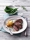 Sous-vide saddle of lamb with potato muffins and beans