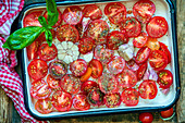 Tomatoes in a tin before roasting