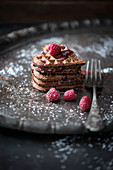 Chocolate waffle hearts with raspberry and chocolate sauce and fresh fruits (vegan)