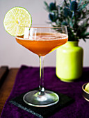 Elegant Lions Tail cocktail with lime garnish