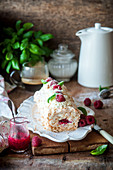 Coconut meringue roll with raspberries