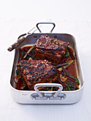 Braised pork belly with with chard in a roasting tin