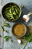 Bowls of okra pods and freekeh