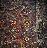 A dark patterned oriental rug