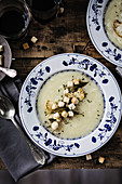 Cauliflower cream soup on a wooden dining table