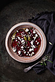 Vegetarian beetroot carpaccio salad with feta cheese, thyme, olive oil and capers