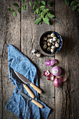 Quails eggs in a blue bowl in a rustic kitchen
