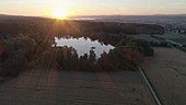 Sunset over a Swiss lake, drone footage