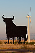 Bull advertising sign and wind turbine