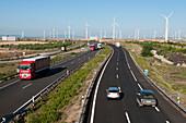 Wind turbines by a motorway