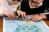 Students measuring distances on a map