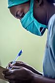 Surgeon making notes