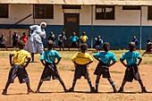 Young schoolchildren exercising
