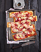 Mozzarella and almond tray bake pizza with onions, ham and cheese