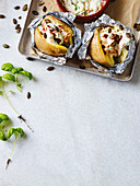 Baked potatoes filled with quark and pumpkin seeds