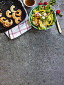 A colourful salad with fried king prawns