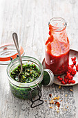 Sweet pesto and pomegranate ketchup as barbecue sauces
