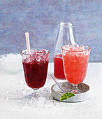 Two mocktails - a Berry Sour and Tropical Fruit