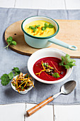 Courgette curry soup, and beetroot soup with date gremolata