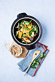 Stir-fried chicken with turmeric and sesame seeds